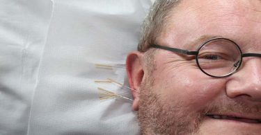 Oor Acupunctuur Man